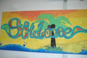 """Schriftzug """"Schüleroase"""" an der Wand"""